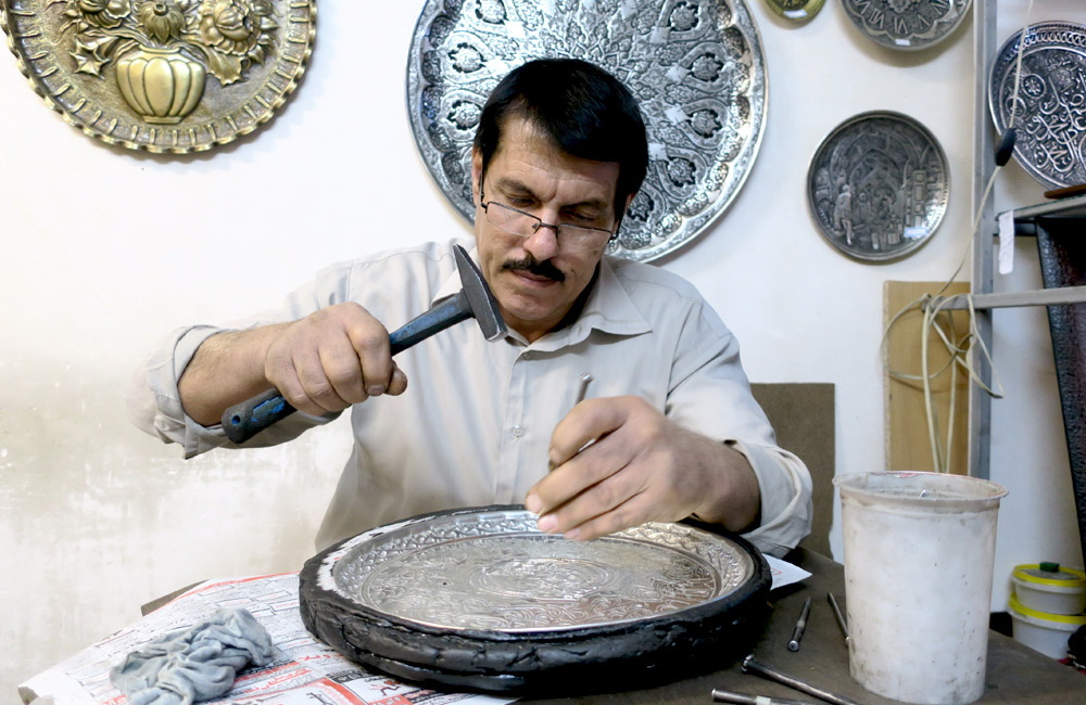 Isfahan's renowned metalwork etch artists